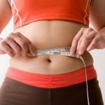 скопление жира на животе причины